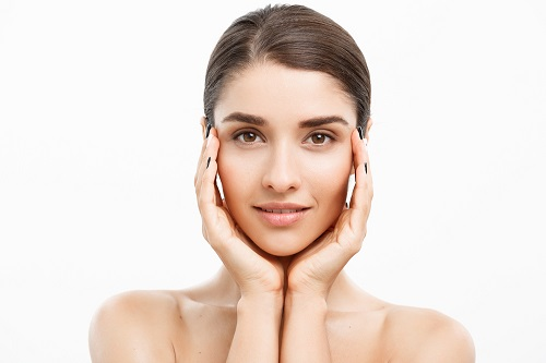 What oil massage brings a natural glow to the face?